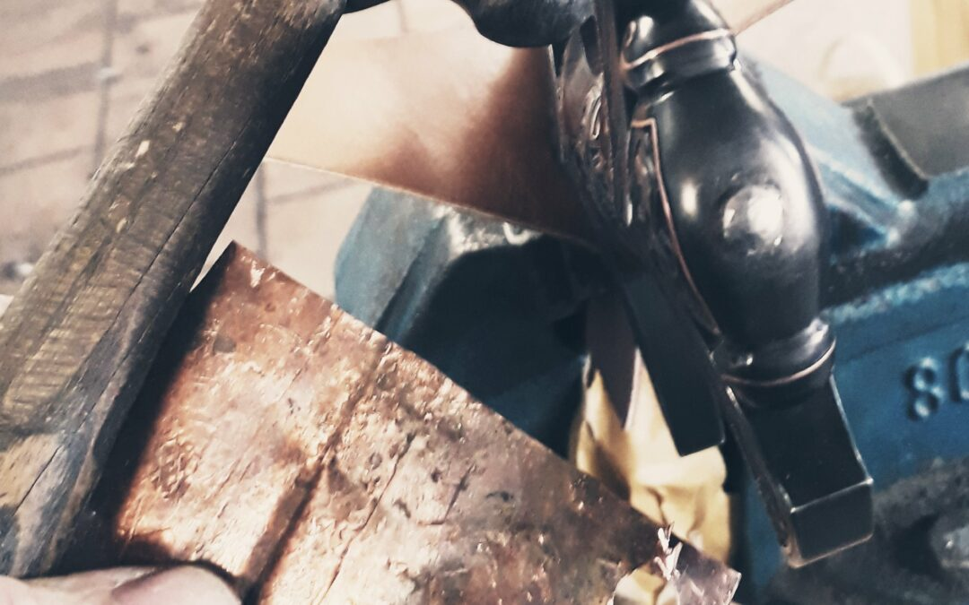 Riveting the sword handle